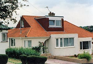 Dormer on a hipped roof with half gable end