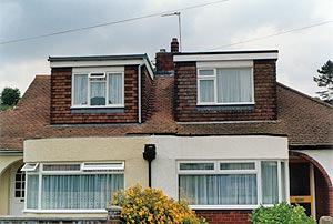 Flat roof dormers – one on a hipped roof, the other with a gable end
