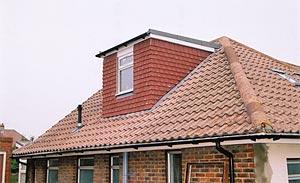 Small central dormer on a four-hipped roof